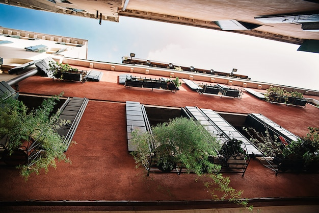 Daylight view from bottom architecture building with red facade Premium Photo
