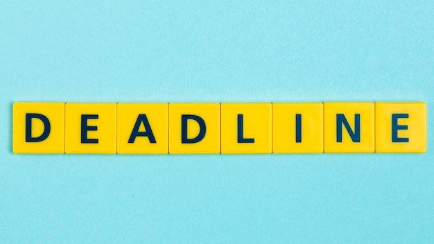 Deadline word on scrabble tiles Free Photo