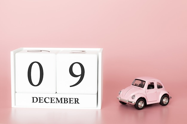 December 09th. day 9 of month. calendar cube with car Premium Photo