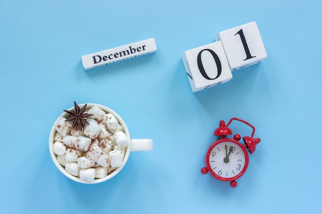 December 1st cup of cocoa with marshmallows and alarm clock Premium Photo