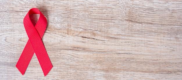 December world aids day awareness month, red ribbon Premium Photo