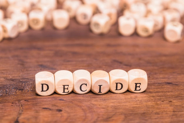 Decide text written on wooden dice Free Photo