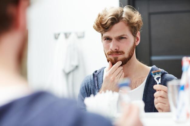 Deciding to shave Free Photo