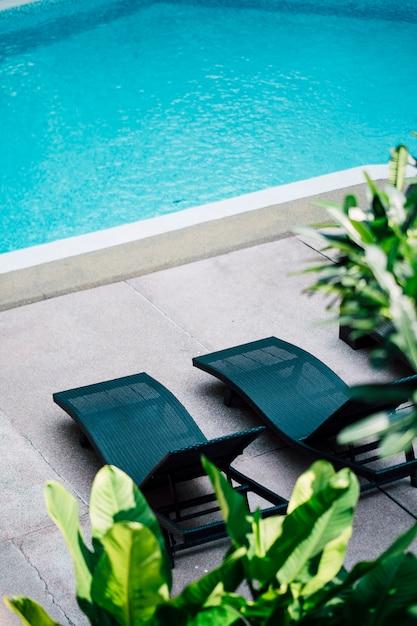 Deckchair at swimming pool Free Photo