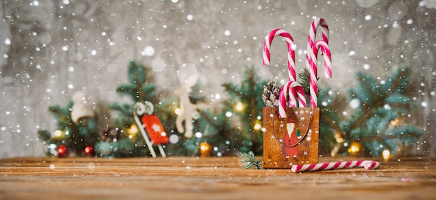 Decor christmas holidays composition on a wooden background with Premium Photo