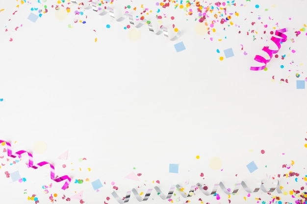 Decorated background with confetti and curl streamers Free Photo