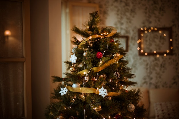 Decorated christmas tree in living room Free Photo