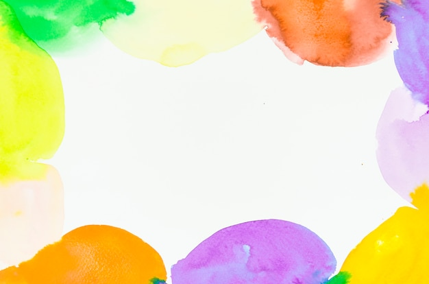 Decorated colorful watercolor blots frame on white background Free Photo