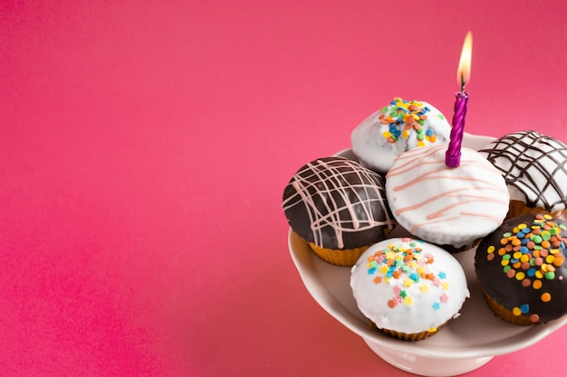 Decorated cupcakes on red table Free Photo