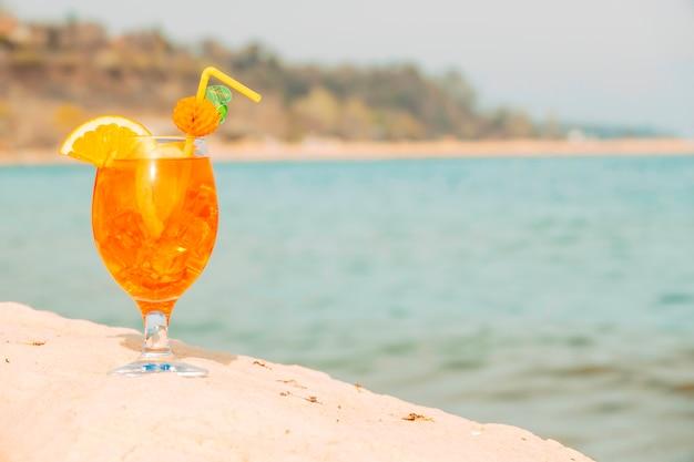 Decorated glass of light orange drink Free Photo