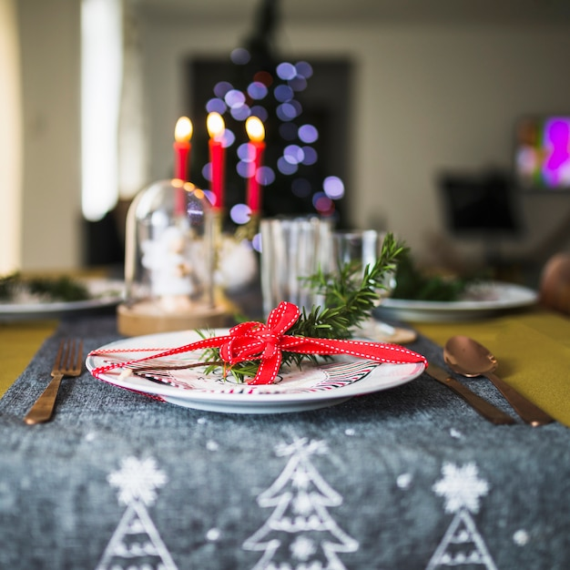 Decorated plate on christmas tablecloth Free Photo