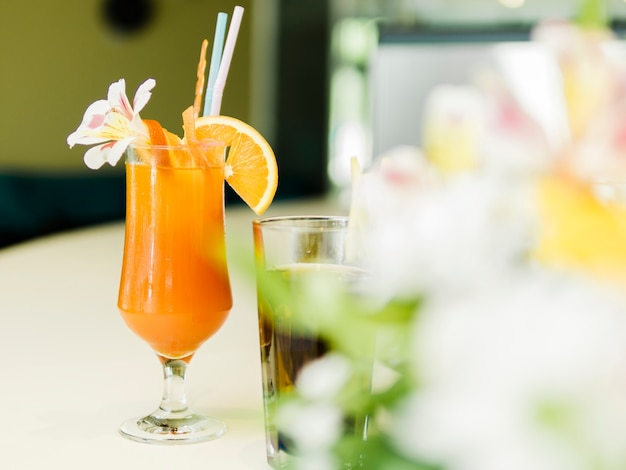 Decorated summer cocktail in bar Free Photo