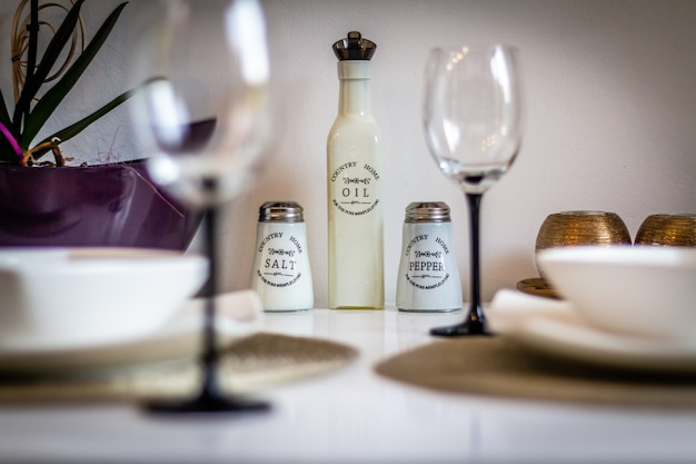 Decorated table in the kitchen with gold fork, spoons and knife and flowers. laid table. table setting. preparing to feast. still life Premium Photo