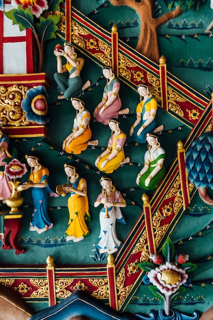 Decorated wall that tell about buddha story in bhutanese art inside the royal bhutanese monastery. Premium Photo