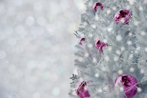 White Christmas Snow Background.Decorated White Christmas Tree On Blurred White Light