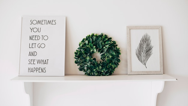 Decorated with picture quote and wreath shelf Free Photo