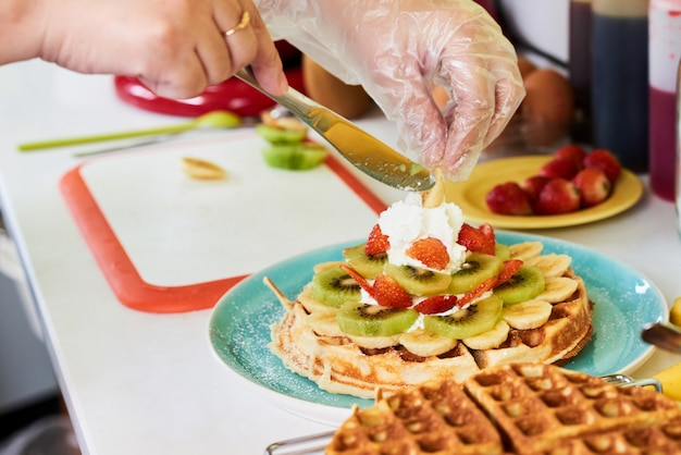 Decorating breakfast waffle Free Photo