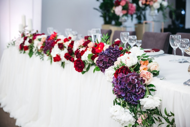 Decorating the table from many colored flowers Free Photo