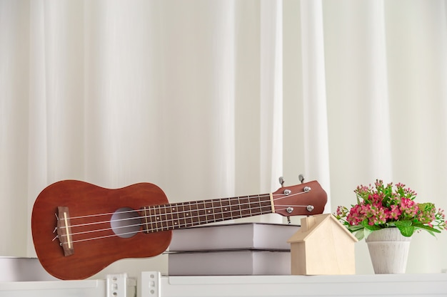 Decoration in bedroom with mini guitar and book with flower. Premium Photo