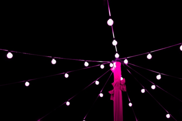 Decoration of glowing pink string light bulb at night Free Photo