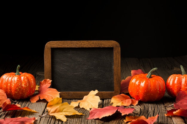 Decoration of pumpkins and autumn leaves Free Photo