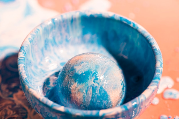 Decoration with blue and white paint in a bowl Free Photo