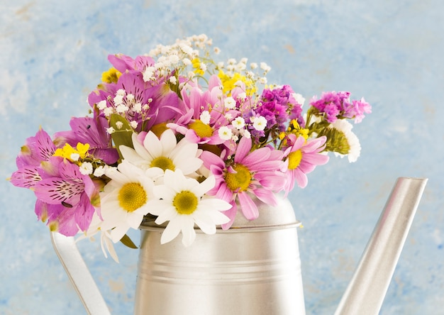 Decoration with flowers in a watering can Free Photo