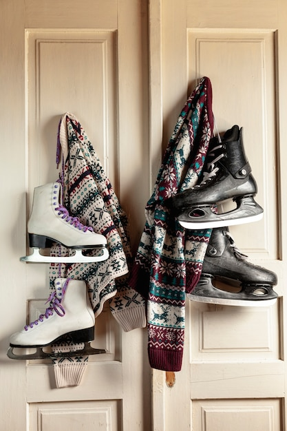 Decoration with sweaters and ice skates hanging on the door Free Photo
