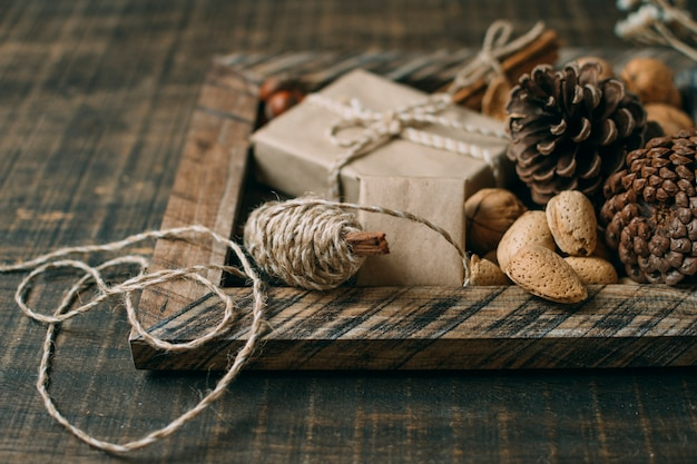 Decoration with wooden frame and cones Free Photo