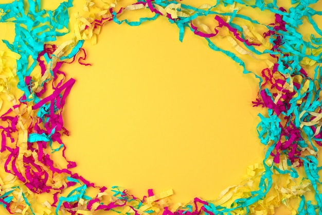 Decorative abstract background of colored paper on a yellow background Premium Photo