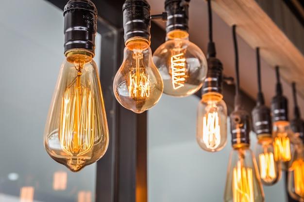 Decorative antique edison style filament old lighting decor bulb in modern building. Premium Photo