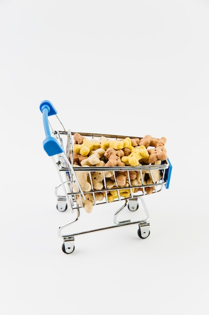Decorative cart with dry pet food Free Photo