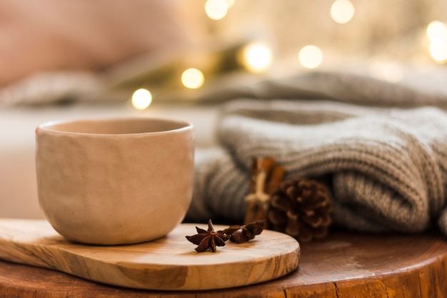 Decorative ceramic cup on wooden hot pad Free Photo