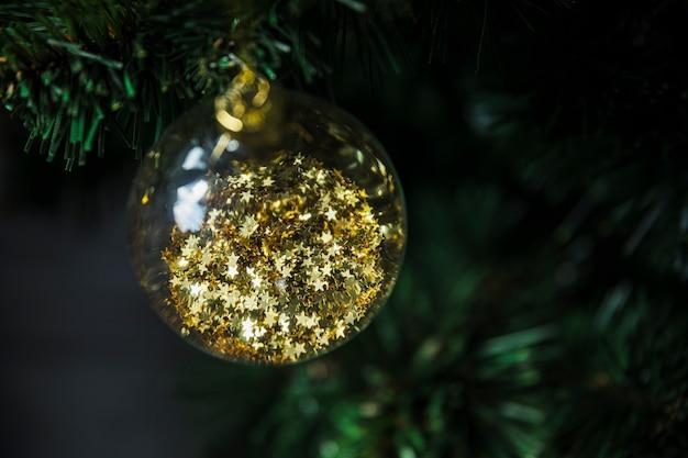 Decorative christmas bauble on fir tree Free Photo