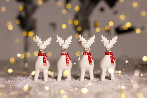 Decorative christmas-themed figurines. christmas deer. Premium Photo