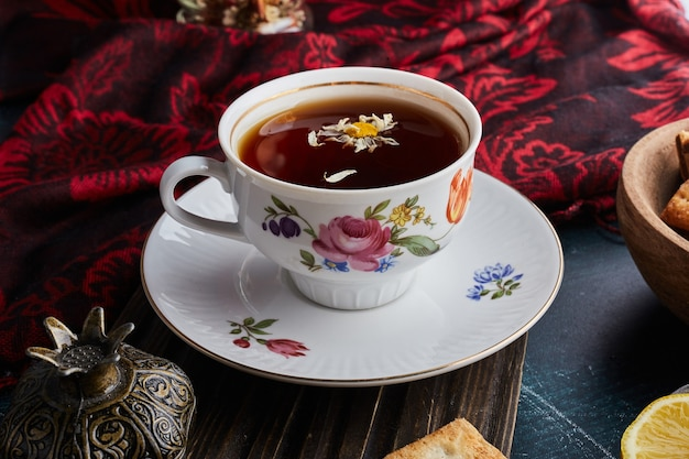 A decorative cup of herbal tea. Free Photo