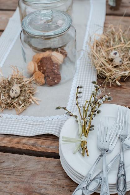 Decorative easter eggs served festive table. farm. rustic style. Premium Photo