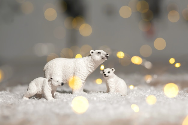 Decorative figurines of a christmas theme. statuettes of a family of polar bears. Premium Photo