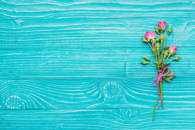 Decorative flowers on blue wooden surface Free Photo