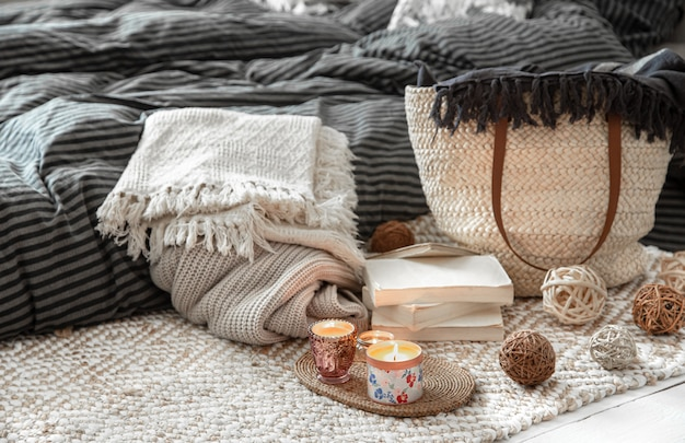Decorative items in a cozy home interior. wicker straw large bag, and decorative elements. Free Photo