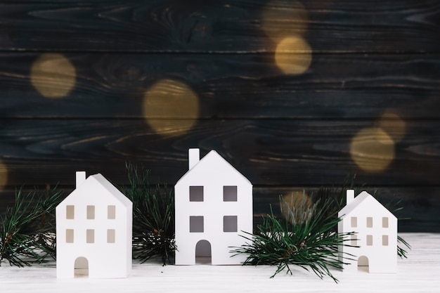 Decorative little houses near twigs Free Photo