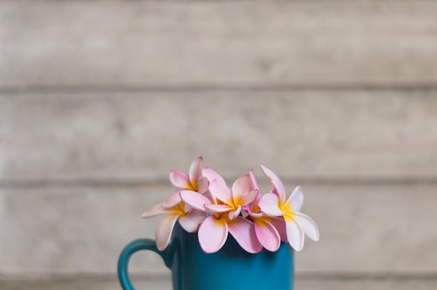 Decorative mug with flowers and blurred backgroun Free Photo