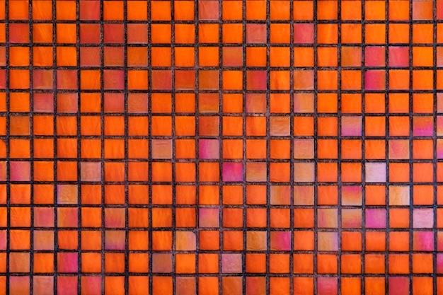 Decorative orange mosaic textured background Free Photo