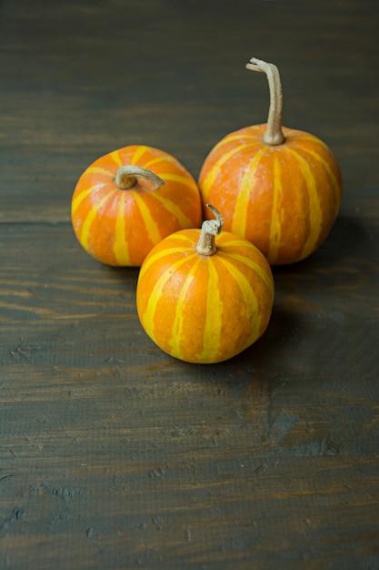 Decorative pumpkin on the table. Premium Photo