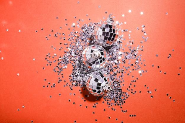 Decorative silver baubles near ornament stars Free Photo