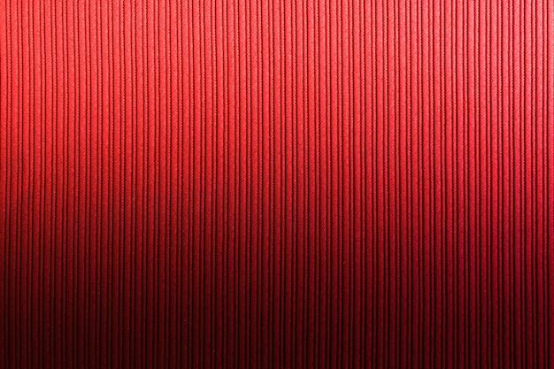 Декоративная поверхность красно-оранжевого цвета, вертикальный градиент полосатой текстуры. обои art. дизайн. Premium Фотографии