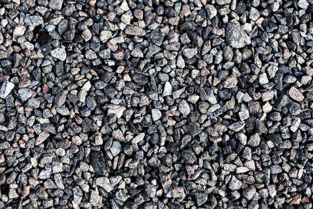 Decorative uneven cracked gravel wall surface Free Photo