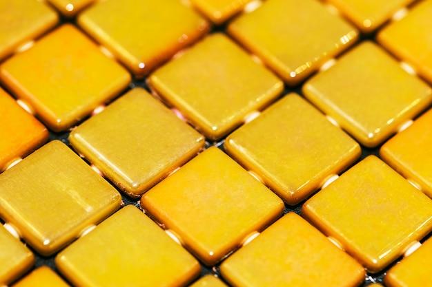 Decorative yellow mosaic textured background Free Photo