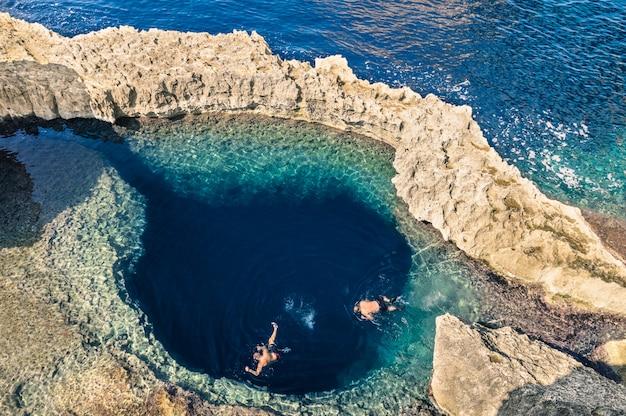 Deep blue hole at the world famous azure window in gozo island Premium Photo
