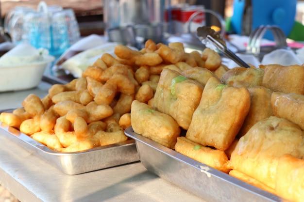 Deep-fried dough stick at market Premium Photo